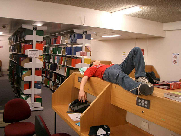 college-guy-sleeping-in-library
